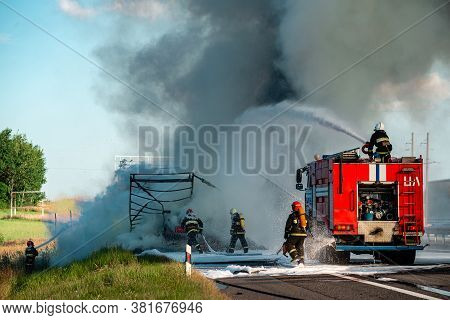 Accident And Fire On The Road, Truck Carrying Fuel Wrecked Into Construction Divider, Driver Survive