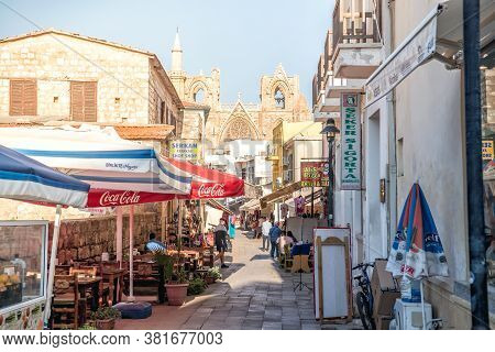 Famagusta, Cyprus - October 15, 2019: Lala Mustafa Pasa Mosque Through Sinan Pasa Shopping Street