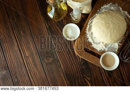 Baking In Rural Kitchen. Dough And Recipe Ingredients On Vintage Brown Wooden Table. Top View. Rusti