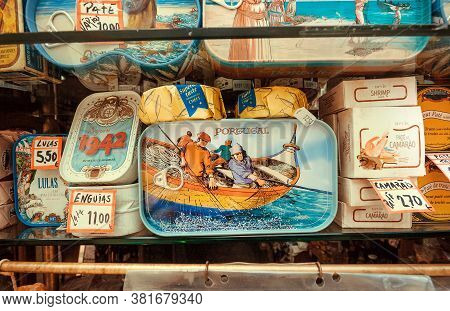 Porto, Portugal: Traditional Seafood With Sardine Fish For Sale, In Store With Asorted Colorful Cann