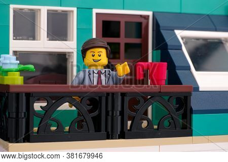 Tambov, Russian Federation - June 26, 2020 Lego Minifigure Businessman Standing On A Balcony And Wav