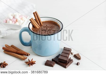 Spicy Hot Chocolate With Cinnamon And Star Anise In Enamel Blue Mug On White Background. Hot Cozy Dr