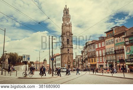 Porto, Portugal: Old Towers Of Porto And Crowd Of People In Local Bars And Cafes On 20 May, 2019. Po