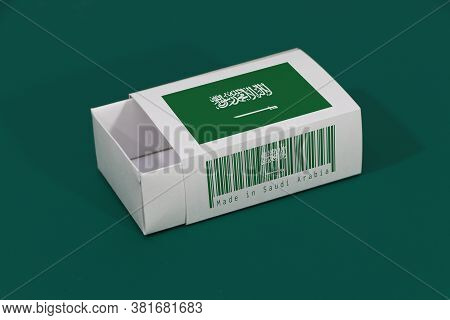 Saudi Arabia Flag On White Box With Barcode And The Color Of Nation Flag On Green Background, Paper