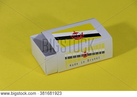 Brunei Flag On White Box With Barcode And The Color Of Nation Flag On Yellow Background, Paper Packa