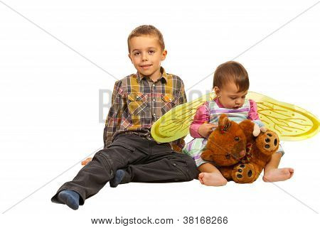 Boy And Little Girl Sitting On Floor