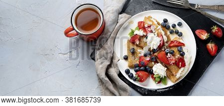 Traditional Crepes With Filling On Gray Background