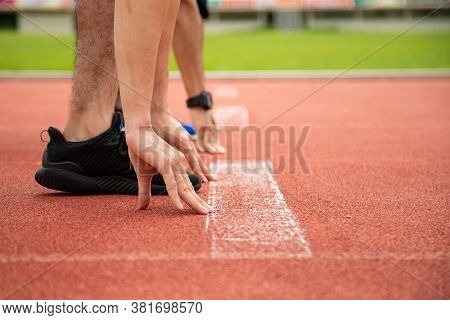 Close Up Of Fit And Confident Two Men In Starting Position Ready For Running. Male Athlete Start A S