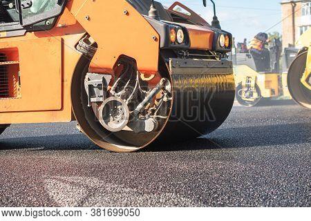 The Roller Flattens The Asphalt Tar, Paving The New Asphalt
