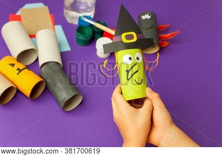 Boy Makes Halloween Toys From Paper. Toilet Roll Tube By Hands. Creative Diy For Kids On Traditional