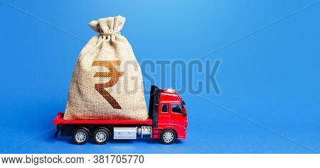 Truck Is Carrying A Huge Indian Rupee Money Bag. Great Investment. Attracting Large Funds To The Eco
