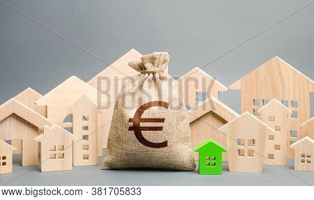 Euro Money Bag And A City Of House Figures. Buying Real Estate, Fair Price. City Municipal Budget. P