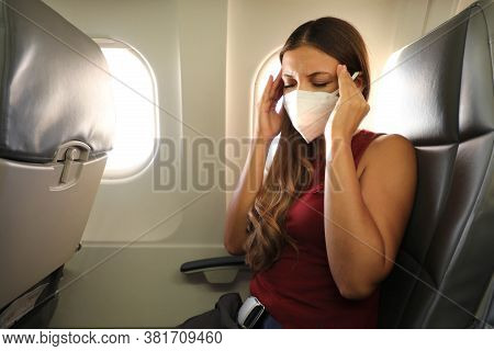 Covid-19 Young Woman With Kn95 Ffp2 Mask Feeling Unwell On Plane. Fear Of Flying Woman In Airplane.