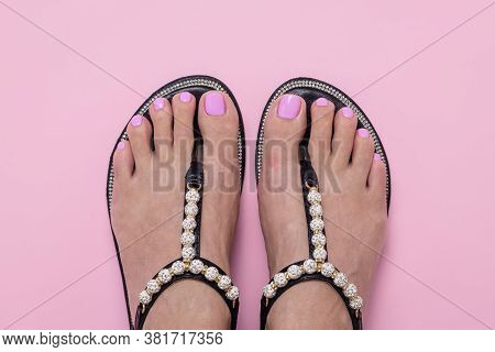 Female Feet In Sandals, Pink Pedicure. Woman Summer Shoes. Nail Care Concept, Chiropody
