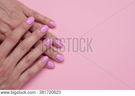 Female Hands With Pink Nail Polish, Glamorous Manicure. Minimalist Design. Place For Text, Empty Spa