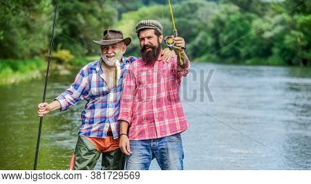 Come Back Home. Hobby And Sport Activity. Trout Bait. Two Happy Fisherman With Fishing Rods. Father