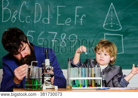 Study In Educational Activity Through Experience. Chemical Invention. School Laboratory. Teacher And