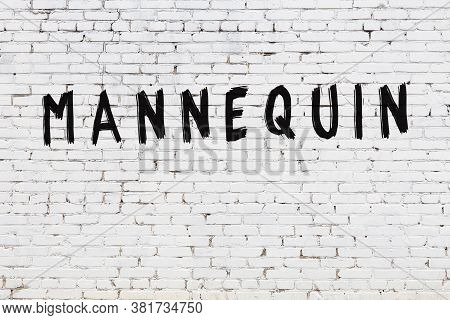 White Brick Wall With Inscription Mannequin Handwritten With Black Paint