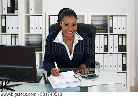 African Professional Accountant Woman With Calculator Doing Accounting