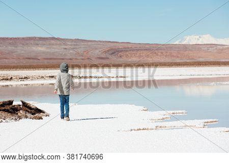 Back View Of Little Boy Hiking And Enjoying Salty Lagunas Escondidas In Atacama Desert, Chile, Healt