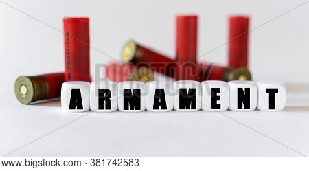 Against The Background Of Rifle Cartridges, There Are White Cubes With Text Armament. Hunting And Da