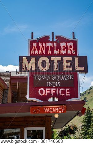 Jackson, Wyoming - June 26, 2020: Sign For The Antler Motel, Located In Downtown Jackson Hole. Retro