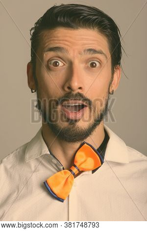 Face Of Handsome Man With Crooked Bow Tie Looking Surprised