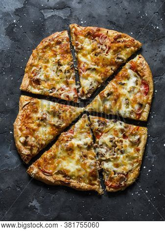 Canned Tuna, Tomatoes, Mozzarella Cheese Puff Pastry Pizza On A Dark Background, Top View. Delicious