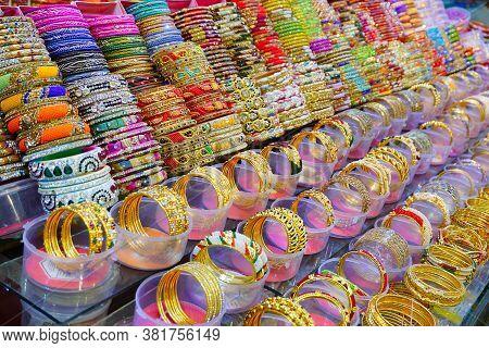 Haridwar, Garhwal, India - 3rd November 2018 : Colourful Bangles Displayed For Sale. Night Image Of