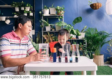 Parent Sitting Homeschooling With Little Kid, Father And Son Having Fun Preparing Easy Science Exper