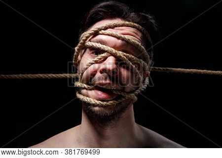 Binded Brunette Man With Rope On Face