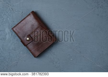 Handmade Genuine Leather Wallet On Dark Concrete Background With Copy Space, Mens Accessories.