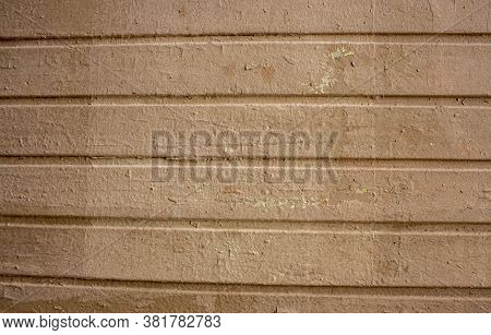 Corrugated Sheet Metal, Badly Painted With Lightdo Brown Paint For Background. Metal Corrugated Roof