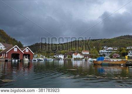 May 10, 2019. South Norway, A Typical Modern Settlement, A Village On The Bay, With Boats, Garages A
