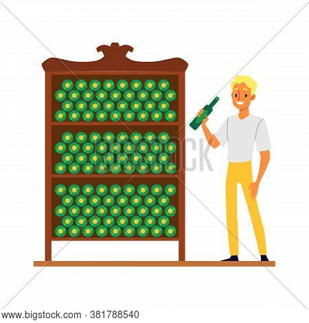 Young Caucasian Man Blond Stands At The Wine Shelves In The Cellar For Storing Bottles Of Wine.