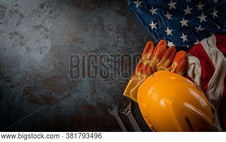 Happy Labor Day Concept. American Flag With Different Construction Tools On Dark Stone Background, W