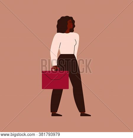 Confident African Businesswoman Stands With A Red Briefcase. A Strong Black Female Entrepreneur Look