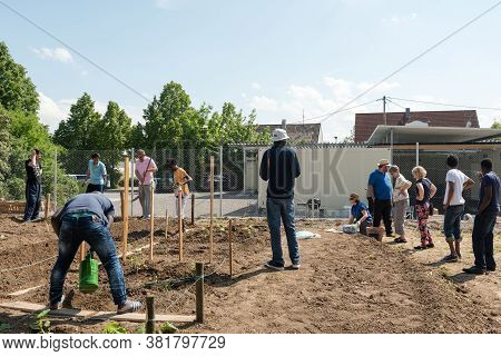 Scharnhausen, Germany - May 26, 2016: German Volunteers Are Supporting African, Arabic And Asian Ref