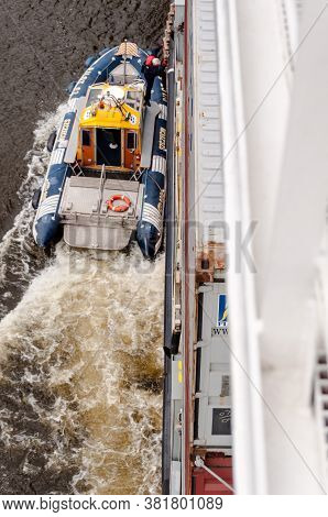 Szczecin, Poland - May 13, 2011: A Pilot Is Entering A Container Ship From His Pilot Boat For Naviga