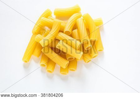 Traditional Italian Pasta Isolated On White Background, Heap Of Tortiglioni Pasta, Durum Wheat Noodl