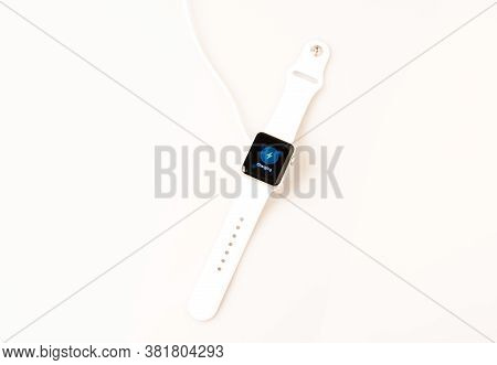 Ostfildern, Germany - April 26, 2015: Charging The New Apple Watch: A White 38mm Apple Watch Sport I