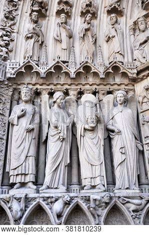 Notre Dame Cathedral-17 July 2010: Portal Statues Of Notre Dame Cathedral, St. Denis Statue