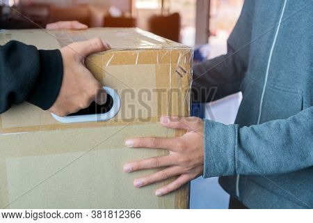 Messenger Or Deliveryman Carry On Parcel Box Package To Deliver Customer At Home. Delivery Service C