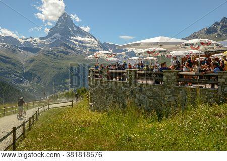 People Eating On The Restaurant Of Sunnegga Over Zermatt In The Swiss Alps