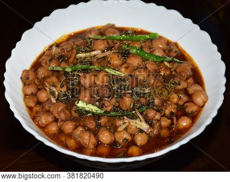 Delicious Indian Food Chole Curry Or Chickpea Dish Served On A White Bowl