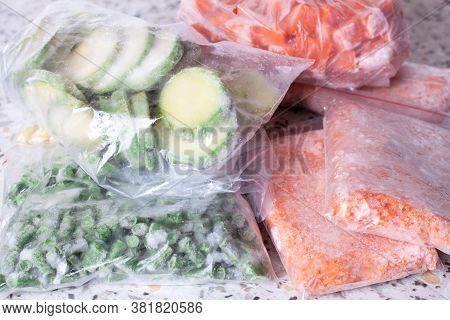 Frozen Vegetables In Plastic Bags On A Table. Frozen Food In The Freezer