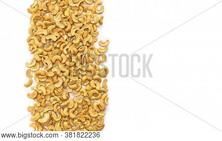 Roasted And Salted Cashew Nuts On A White Background With Space For Text. Top View, Flat Lay.