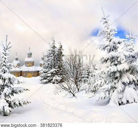 Winter Landscape With Of Fir Tree Forest And Church In Snow With Path. Christmas Landscape