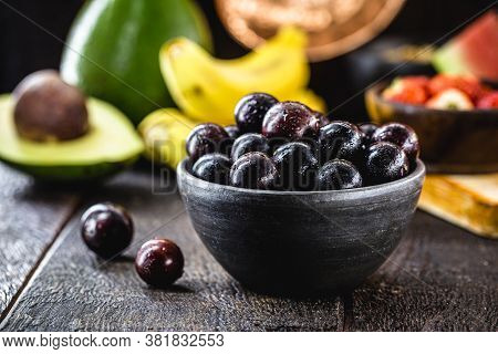 Jaboticaba Or Jabuticaba, Brazilian And South American Fruit, In A Clay Pot. With Tropical Fruits In