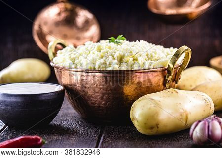 Cream Or Mashed Potato, Served In A Metallic Copper Pot, Organic And Homemade Food Without Preservat
